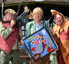 Michael Fabricant (centre) with Jeff Bradbury and Jester Terry Bailey with one of the new stamp designs