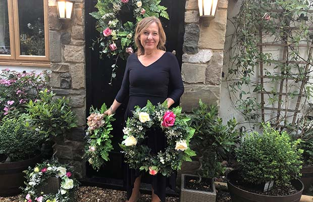 Julie Peters with some of her wreaths