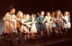 Students performing in Annie Jr