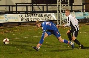 Liam Kirton battles for the ball against Stafford Rangers