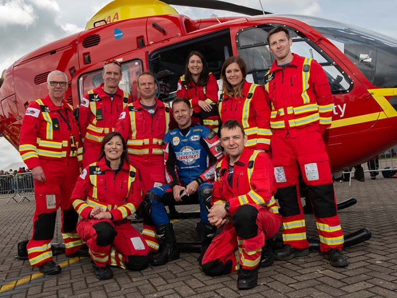 Former British Superbike champion Neil Hodgson with members of the Midlands Air Ambulance team