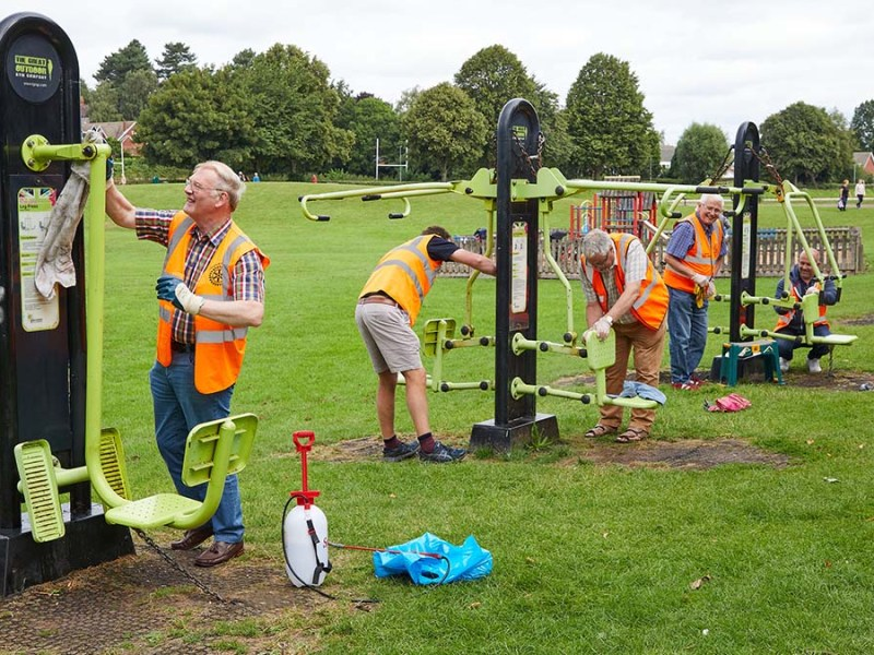 The Lichfield St Chad Rotary Club volunteers cleaning the outdoor gym equipment