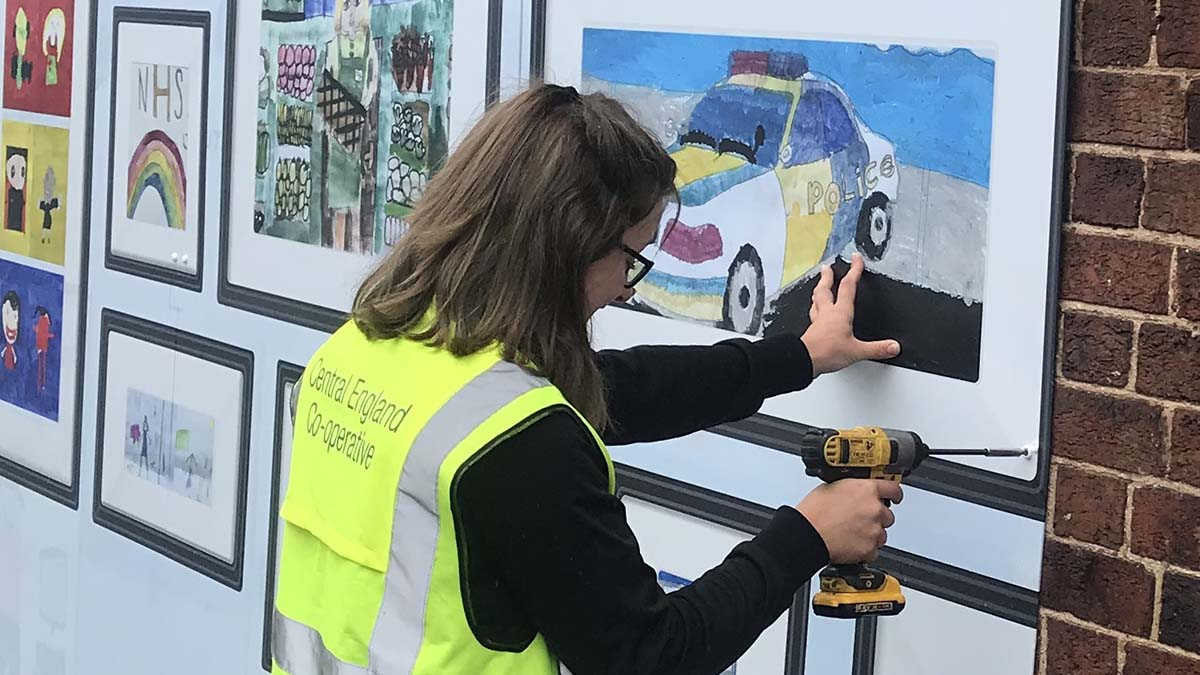 Sophie Mead working on a community art installation for Central England Co-op