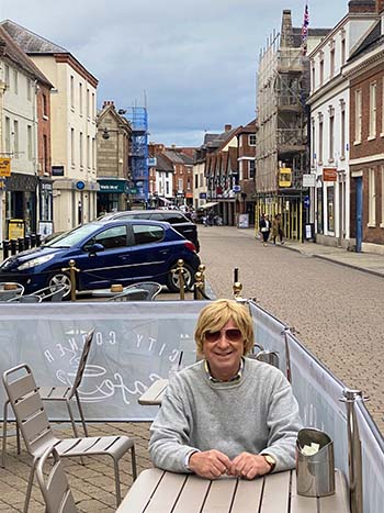 Michael Fabricant in the outdoor seating area at Corner Cafe on Bore Street