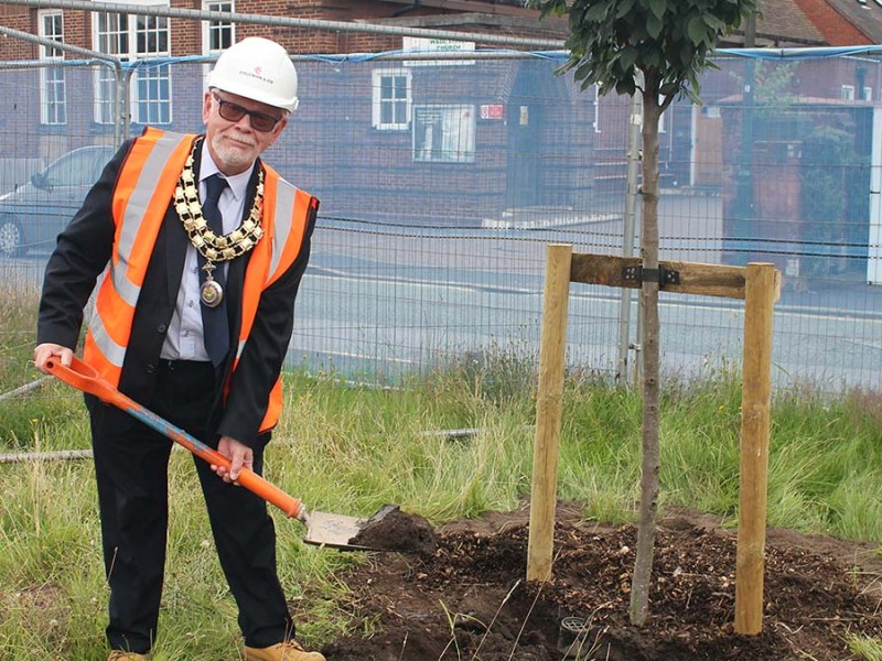 Cllr Joseph Powell planting a tree on the former Lichfield police station site