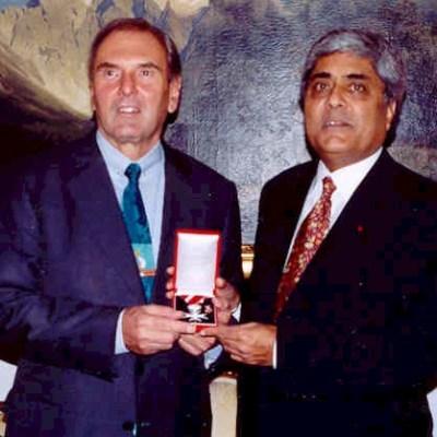 Ambassador Wendelin Ettmayer of Austria presents Mr. Liddar with Austria's decoration of merit in silver for promoting Canada-Austria relations.