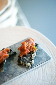 closeup of tuna on wasabi cracker
