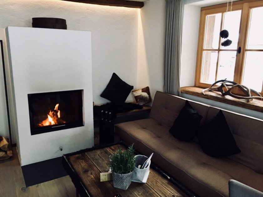 Open fireplace in the design chalet