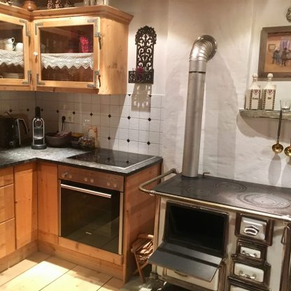 Homely kitchen with old fireplace stove