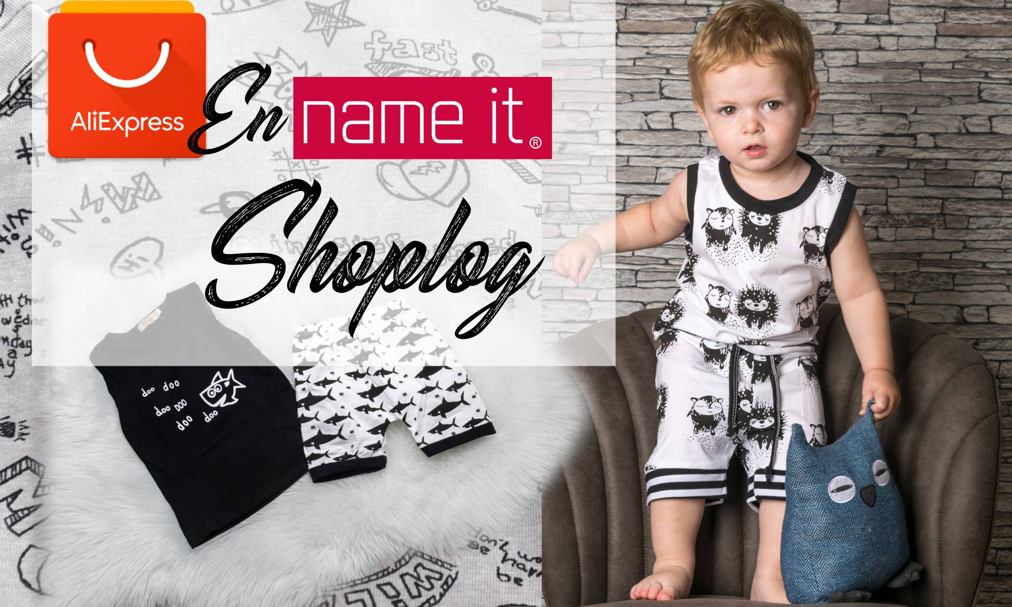 Shoplog AliExpress en Name it jongenskleding - Pyjama zwart wit haai to the moon and back onesie slabbers monochrome fox