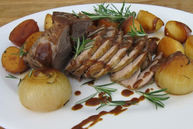 Slow Roasted Lamb with Crispy Potatoes, Onion and Creamy Gravy