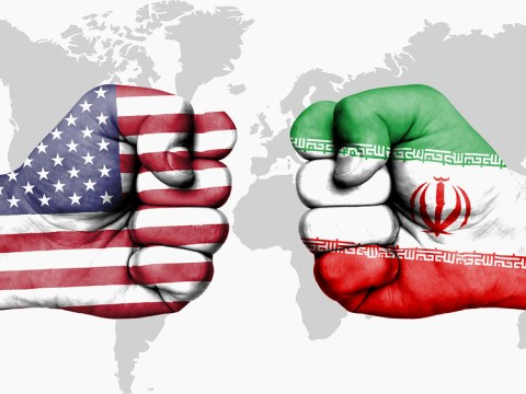 Conflict between USA and Iran male fists - governments conflict concept