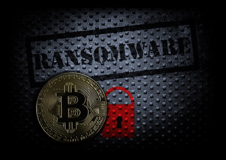 Ransomware text with red lock and a bitcoin