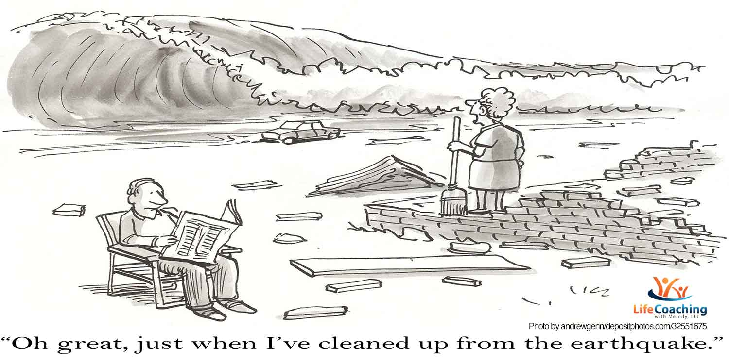 """Cartoon image of man reading newspaper in chair and woman standing on bricks on beach looking at incoming tsunami and words """"Oh great, just when I've cleaned up from the earthquake."""" For coaching blog post titled, """"What to do when life is up-in-the-air?"""" Crossroads"""