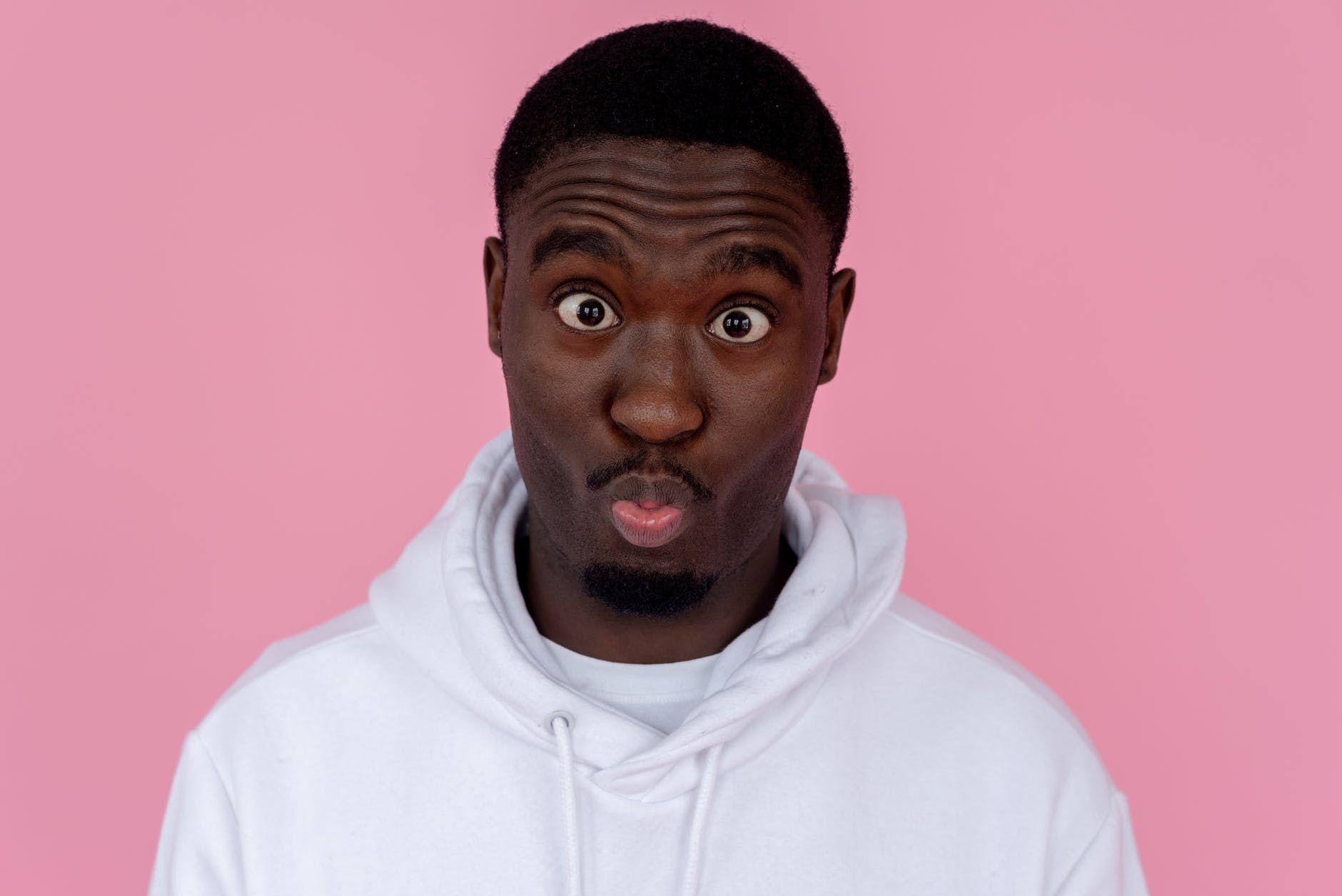 funny black man making grimace and pouting lips