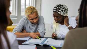 black students reading assignment in textbook