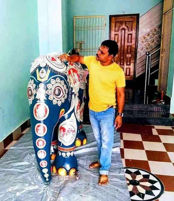 Final touches to pattachitra art
