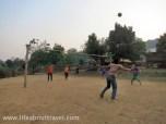 Teenagers playing Sepak takraw