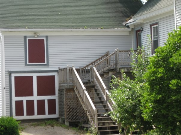 """The """"barn door"""" and steps to an inlaw apartment."""