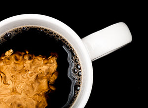 adding cream to coffee