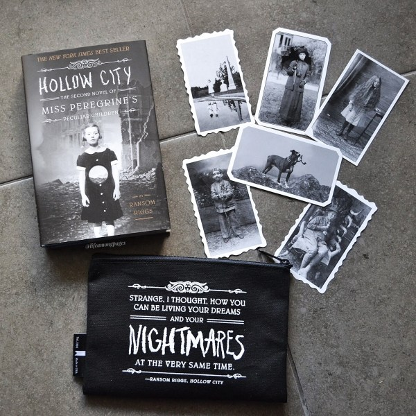 Miss Peregrines: Hollow City by Ransom Riggs beside vintage photos that are included in the hardcover box set edition of the series and with a canvas pouch featuring a quote from the book on it.