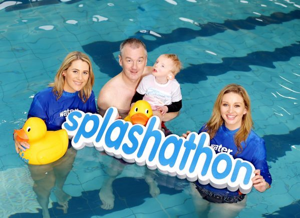 Dublin Footballing Legend John O'Leary and his son Tom (aged 4) pictured with RTE Sports Presenter Evanne Ní Chuilin & TV3 Ireland AM presenter Anna Daly at the launch Water Babies Splashathon 2015, a sponsored swim for babies and toddlers which will take place at Water Babies swimming classes between Monday 20th  – Sunday, 26th  April 2015.