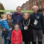 Kieran McCarthy was awarded the Lord Mayor's Medal by Dublin's Lord Mayor Críona Ní Dhálaigh, at the beginning of the 36th SSE Airtricity Dublin Marathon. Kieran received this award in recognition of his fundraising efforts for TLC4CF and Clare Crusaders Clinic as they have supported his family over the last five years since his Aoibheann (7) was diagnosed with Cystic Fibrosis. As part of the 'Team Aoibheann' Challenge, Kieran cycled 200km from Dublin to Shannon on Sunday, swam 10km that morning and cycled 200km back to Dublin before taking part in the Dublin Marathon this morning. Kieran was nominated for this year's Medal by his wife Sinead and his daughter Aoibheann and is photograpohed with Oisín, 2, and race director Jim Aughney before the start. SSE Airtricity Dublin City Marathon. Dublin. Picture credit: Ray McManus / SPORTSFILE