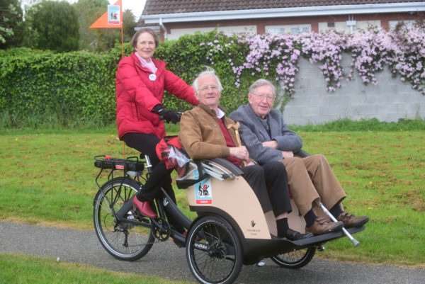 Clara Clark a Cycling Without Age pilot with passengers Charles Mollan , left, and John O'Keefe taking a spin in their local park in Blackrock Co. Dublin. Photograph Moya Nolan
