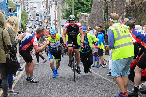 A cyclist is helped up the gruelling Patrick's Hill in Cork city at the end of the 2017 Tour de Munster cycle on on Sunday, August 13th. Over 100 amateur cyclists joined cycling legend Sean Kelly for the demanding four day, 600km charity cycle through all the counties of Munster in aid of Down Syndrome Ireland (Munster branches), as well as a number of individual beneficiaries. For more information see www.tourdemunster.com. Pic: Diane Cusack