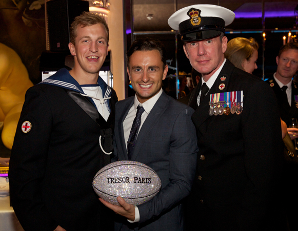 Tresor Paris Rugby Ball and Members of the British Navy.
