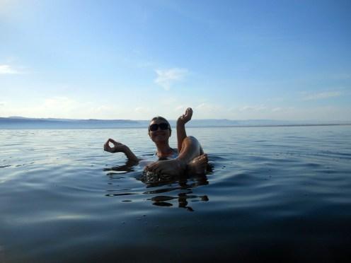 yoga pose in the Dead Sea