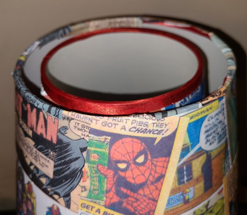 Edges of the comic book pages are folded down over the top edge of the Superhero Lamp update.