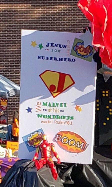 Superhero trunk or treat idea: Superhero Jesus poster that has Psalm 98:1 on it, Luke 19:10, and a J logo like Superman's.