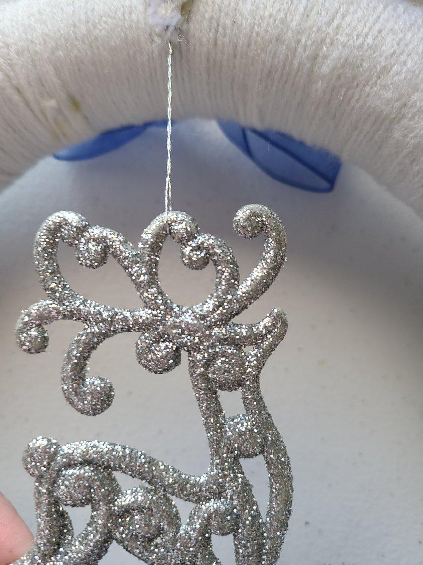 Silver glitter reindeer adorning DIY Christmas decorations.
