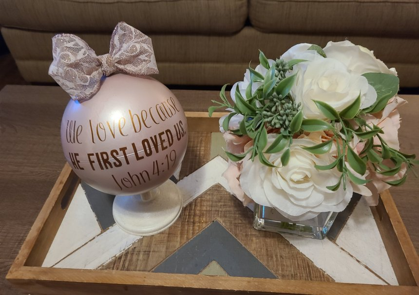 Coffee table display of flowers and Valentine's DIY globe.