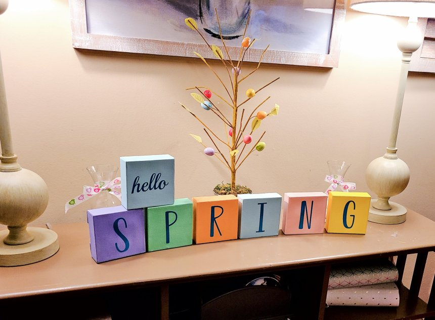 """Seven 4x4 canvases painted in spring colors, """"hello"""" on one, and S P R I N G on six others.  DIY Spring decor"""