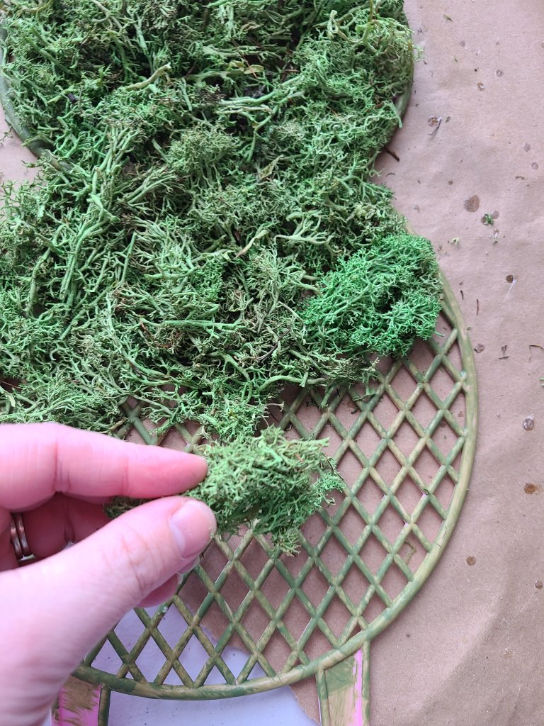 Adding green reindeer moss to the moss covered bunny.