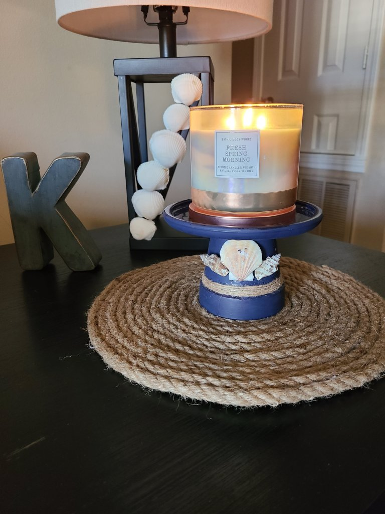 "Quick summer vignette with metal ""K"" and candleholder."