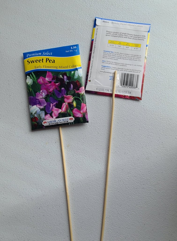 Sweet pea flower seeds and phlox flower seed packets taped to a wooden skewer to go into the end of the year teacher's gift.