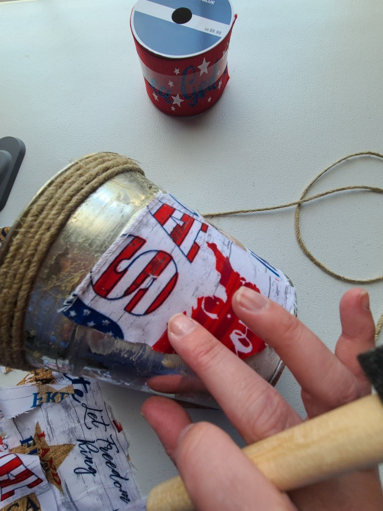 Smooth out any wrinkles or bubbles in the fabric with your finger on your patriotic centerpiece.