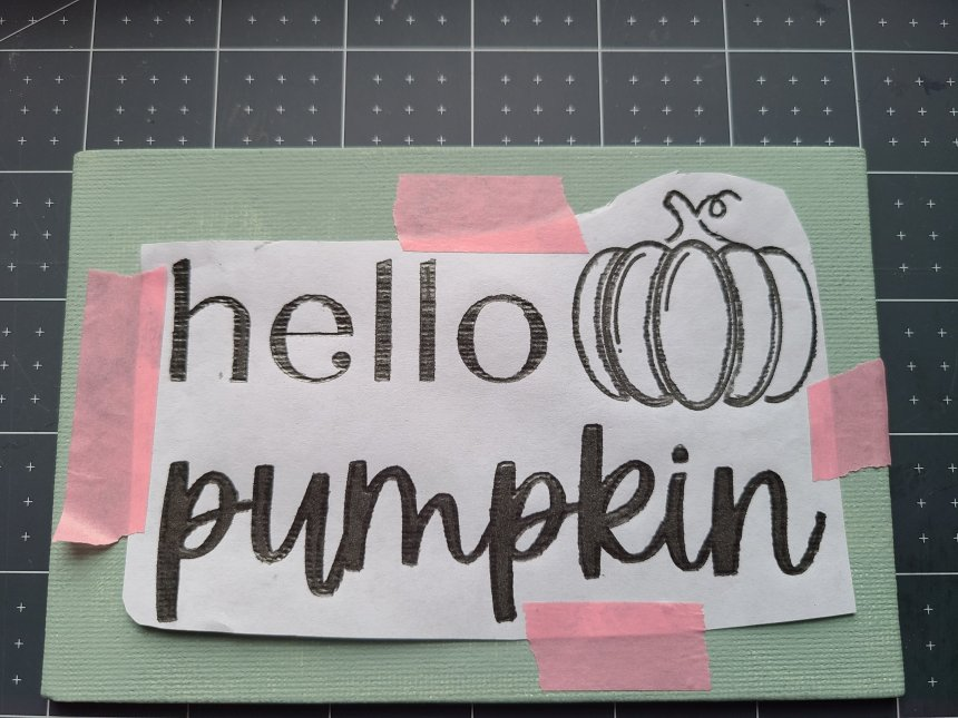 Printed design on paper taped and traced over on canvas DIY sign without a Cricut.