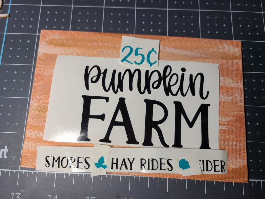 Vinyl lettering on the canvas that will be added to the top of the DIY fall centerpiece.