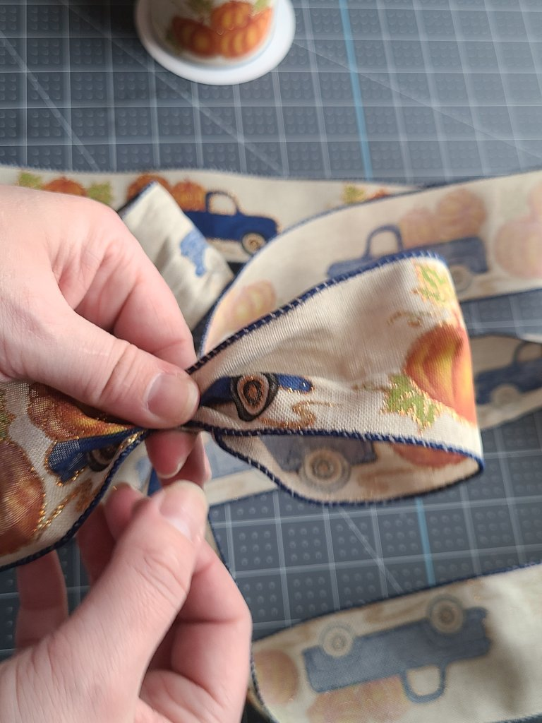 First loop made in the tutorial for how to make a bow for a wreath.