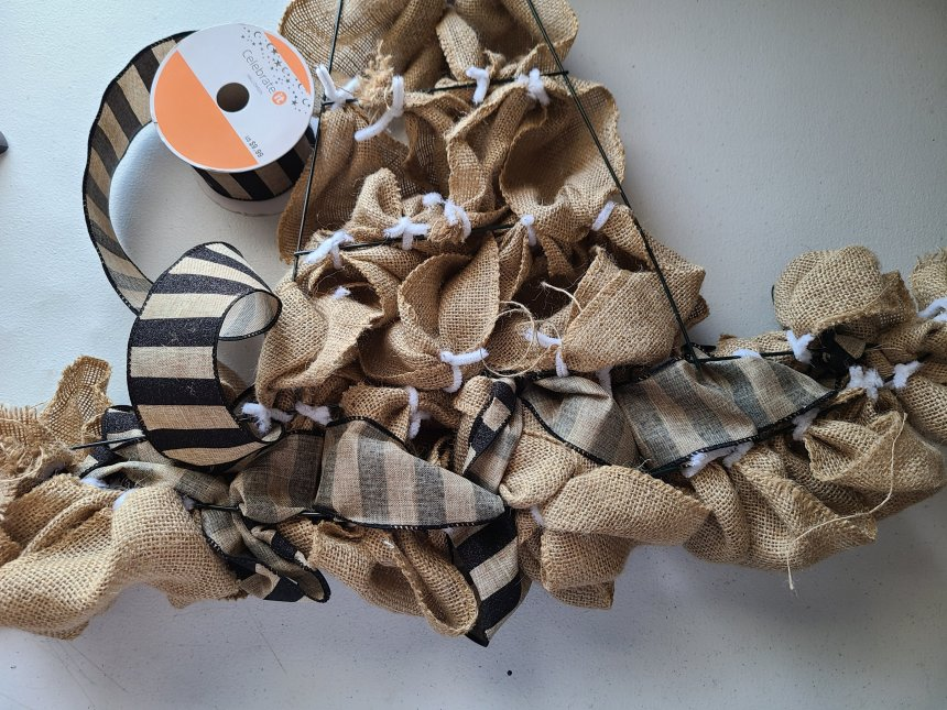 View from the back of the burlap witch hat wreath when you start to add the accent ribbon.