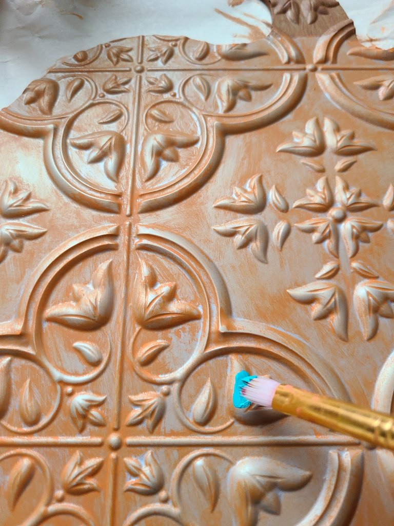 Painting the flowers on the faux tile aqua on the fall pumpkin sign.