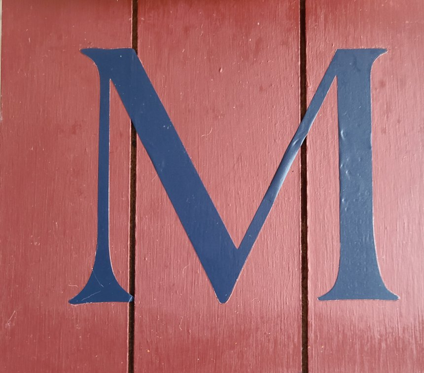 HTV navy letter M on the fall home sign painted burgundy.