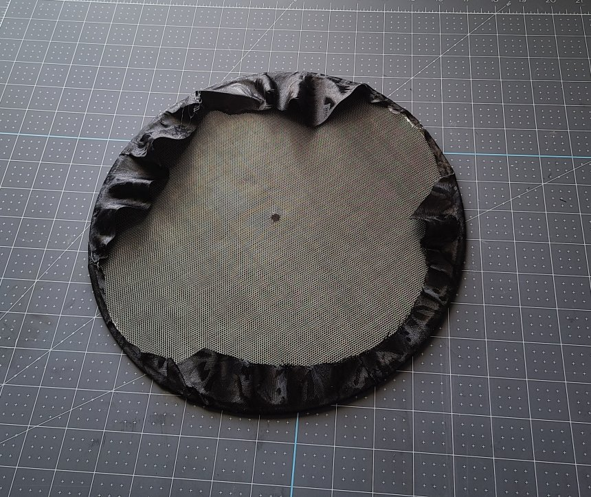 The back of the splatter screen covered with black fabric before it's added to the Halloween splatter screen pumpkin.