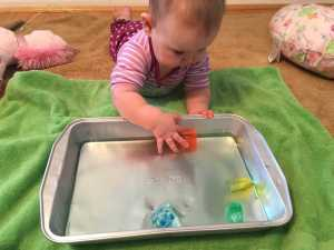 Activities for you 6 month old: Colored Ice Cube Chase
