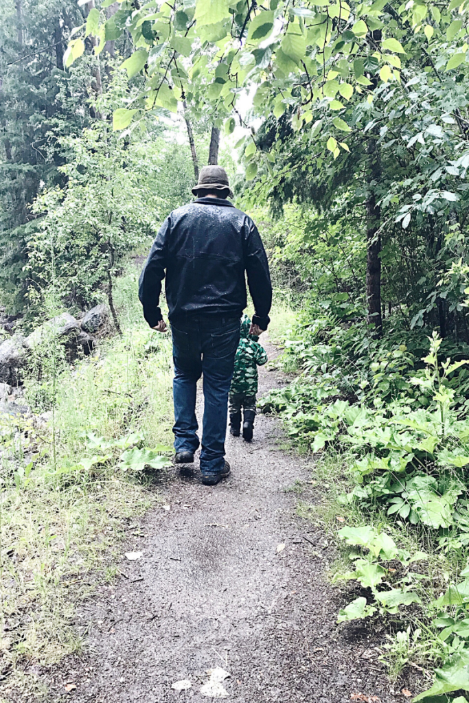 Father and son walking in the rain on a summer day | Life as Mrs Mum