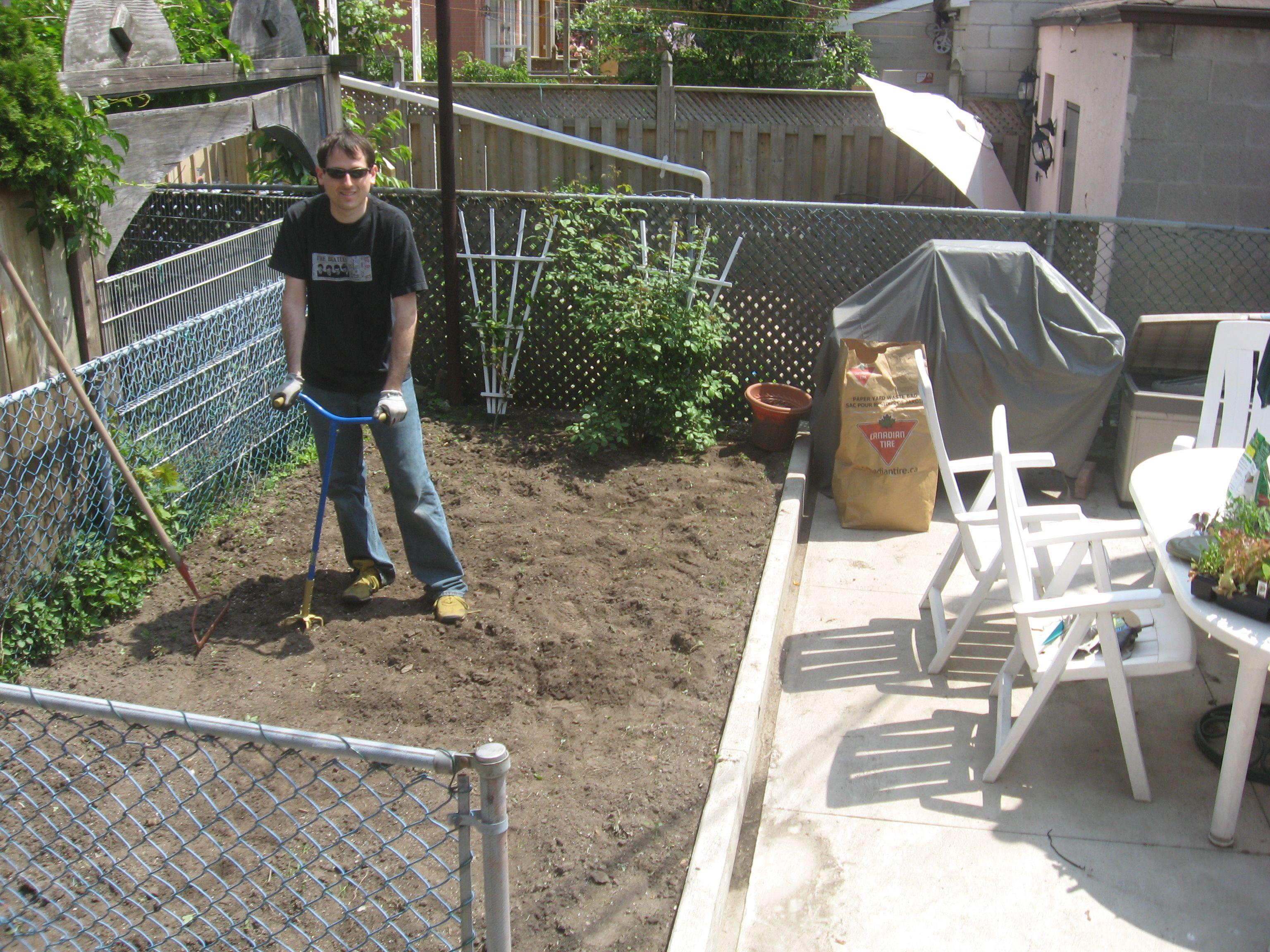 Adam prepping our garden plot.
